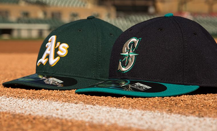New Era Caps der Oakland Athletic's und den Seattle Mariners.
